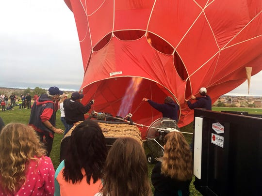 A crew from the upcoming Albuquerque International Balloon Fiesta inflate their balloon for students at Enchanted Hills Elementary School in Rio Rancho, N.M. The 47th Albuquerque International Balloon Fiesta is set to start Saturday, Oct. 6, 2018, and will feature nearly 600 hot air balloons. The event is expected to draw around million visitors to central New Mexico but comes as Albuquerque continues to struggle with crime.