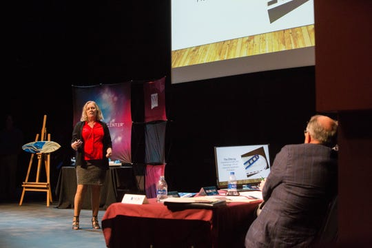 Robin Benson, an electrical and computer engineering student at New Mexico State University, presents to the Aggie Shark Tank, Thursday October 4, 2018, her business — True Spine, a product that could be used in emergency situations.