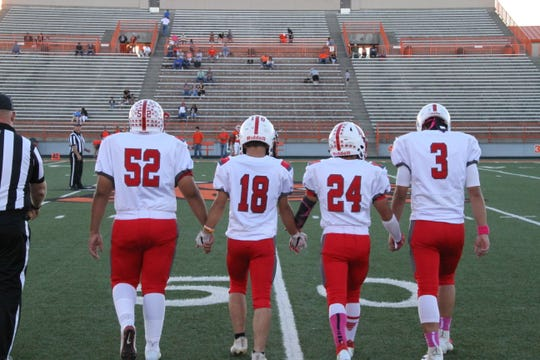 The Loving captains head to midfield for the coin toss before Thursday's game against Artesia's JV team.