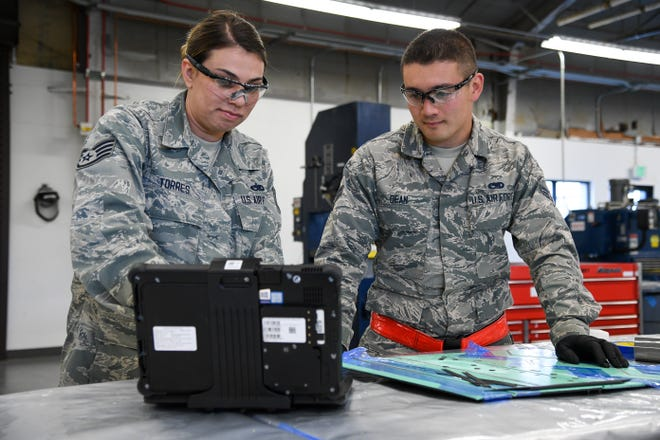 Aircraft maintainers Staff Sgt. Rio Torres, 388th Maintenance Squadron, and Airman 1st Class Jacob Dean, 419th Maintenance Squadron, use a new hand-held tablet connected to a keyboard while working in a back shop at Hill Air Force Base, Utah, Oct. 4. The new tablets will replace the laptops currently used by Total Force Airmen maintaining F-35A's at Hill.