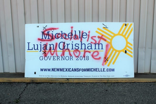 Vandalized Grisham sign