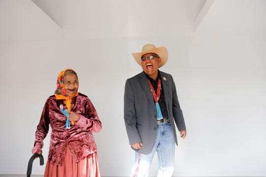 Emma Roanhorse and Navajo Nation Council Delegate Steven Begay share a laugh Aug. 21 after Roanhorse was presented with a key to her new summer cottage in the Ch'ooshgai Mountains' Naschitti Chapter area.