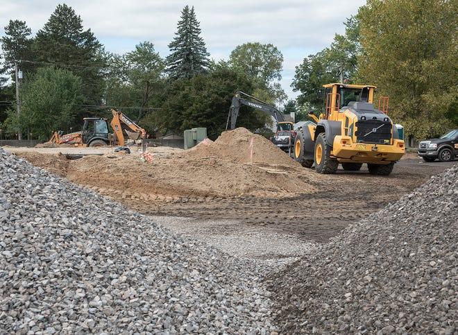 It's all gravel, sand, foundation footings, and construction equipment now, but soon a Starbucks and more will rise on ths property in Milford.