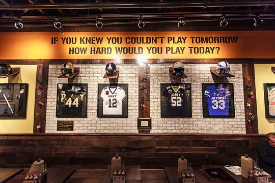 The branches of the U.S. military and their football programs are saluted on this wall at the Evansville, Ind., restaurant.