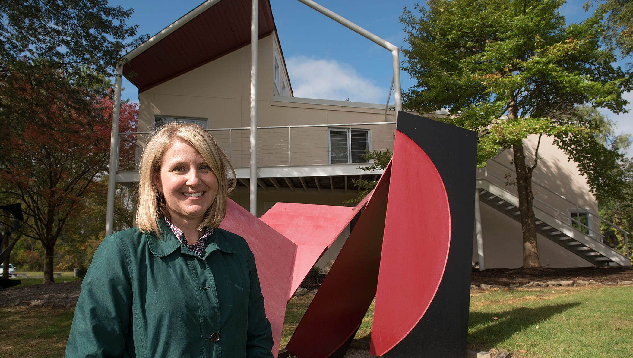 Tracie Ringle is Deputy Director of Novi Parks. The work behind her is Structurist Sculpture No. 10.