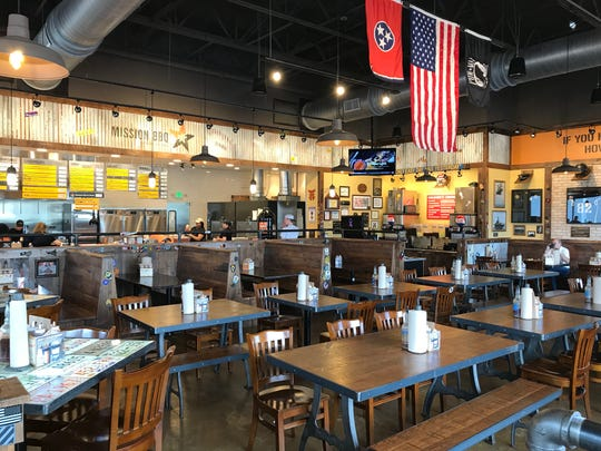 Flags fly inside MISSION BBQ in Clarksville, Tenn.