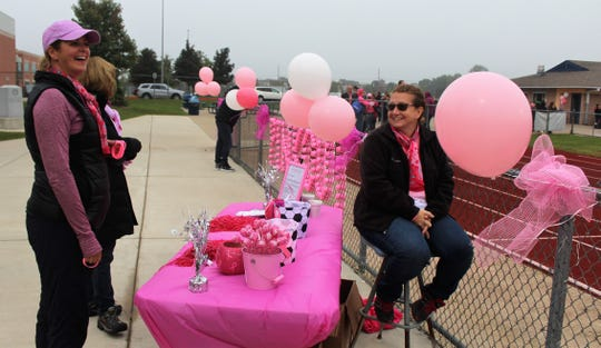 South Lyon Booster Club members Jen Michaels (left to right), Kim Troost and Betsy Writer enjoy the festivities at the recent Pink Out boys soccer game.