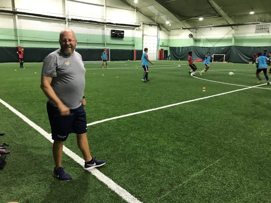 This moment during Thursday's practice at Total Soccer in Farmington shows that Schoolcraft head coach Rick Larson still enjoys what he does.