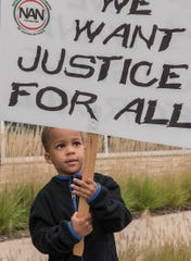 Jase Diamond, who is almost 4 years old, was protesting outside Westland City Hall on Friday.