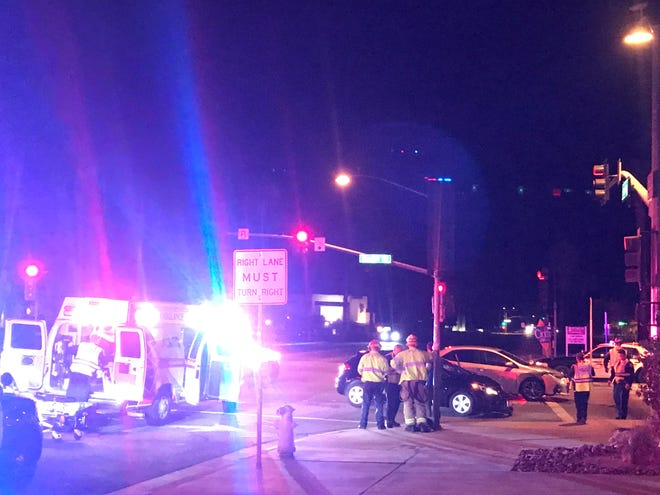 Emergency personnel at the scene of a 2-car crash Thursday night at Sunrise Way and Ramon Road in Palm Springs.