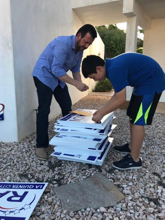 Robert Radi and son Max preparing campaign signs