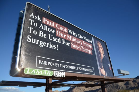 "A billboard off Highway 62 just outside downtown Joshua Tree reads, ""Ask Paul Cook Why He Voted To Allow Our Military Funds to Be Used For Sex-Change Surgeries!"" At the bottom, it reads ""Paid for by Tim Donnelly for Congress."""