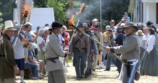 Civil War reenactors in 2012 bring to life the burning of the Bagdad lumber mills during the Civil War as the Confederates tried to deny the mill and other supplies they thought would be valuable to the invading northern troops.