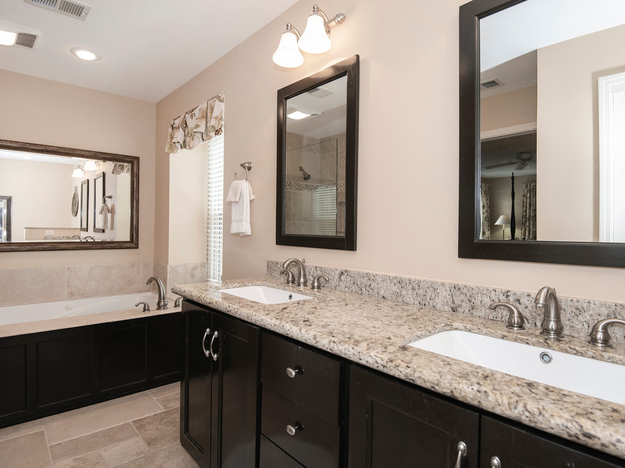 2625 Tambridge Circle, the master bath is relaxing and spa like.