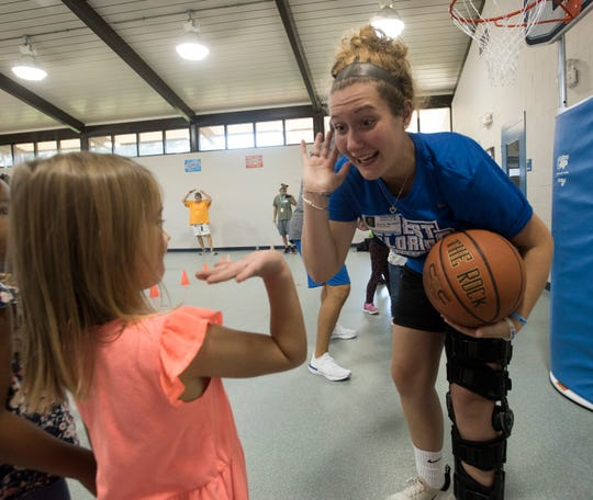 Hayley Bardwell, a member of the University of West Florida women's basketball team, spends time Friday with students at Navy Point Elementary School during United Way of Escambia County's Day of Caring.