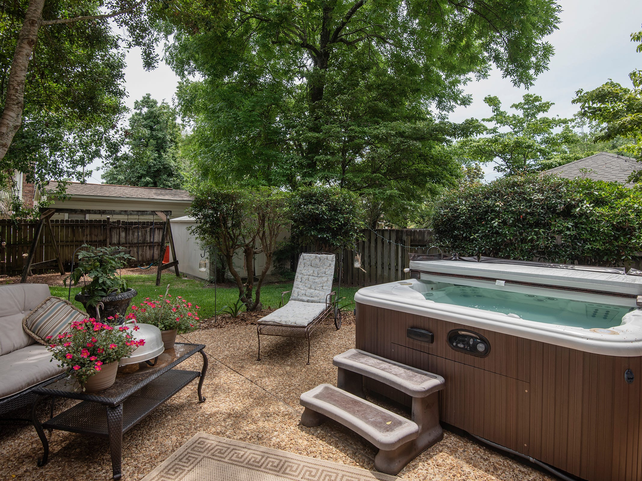 2625 Tambridge Circle, the lush, private rear lawn with a hot tub.