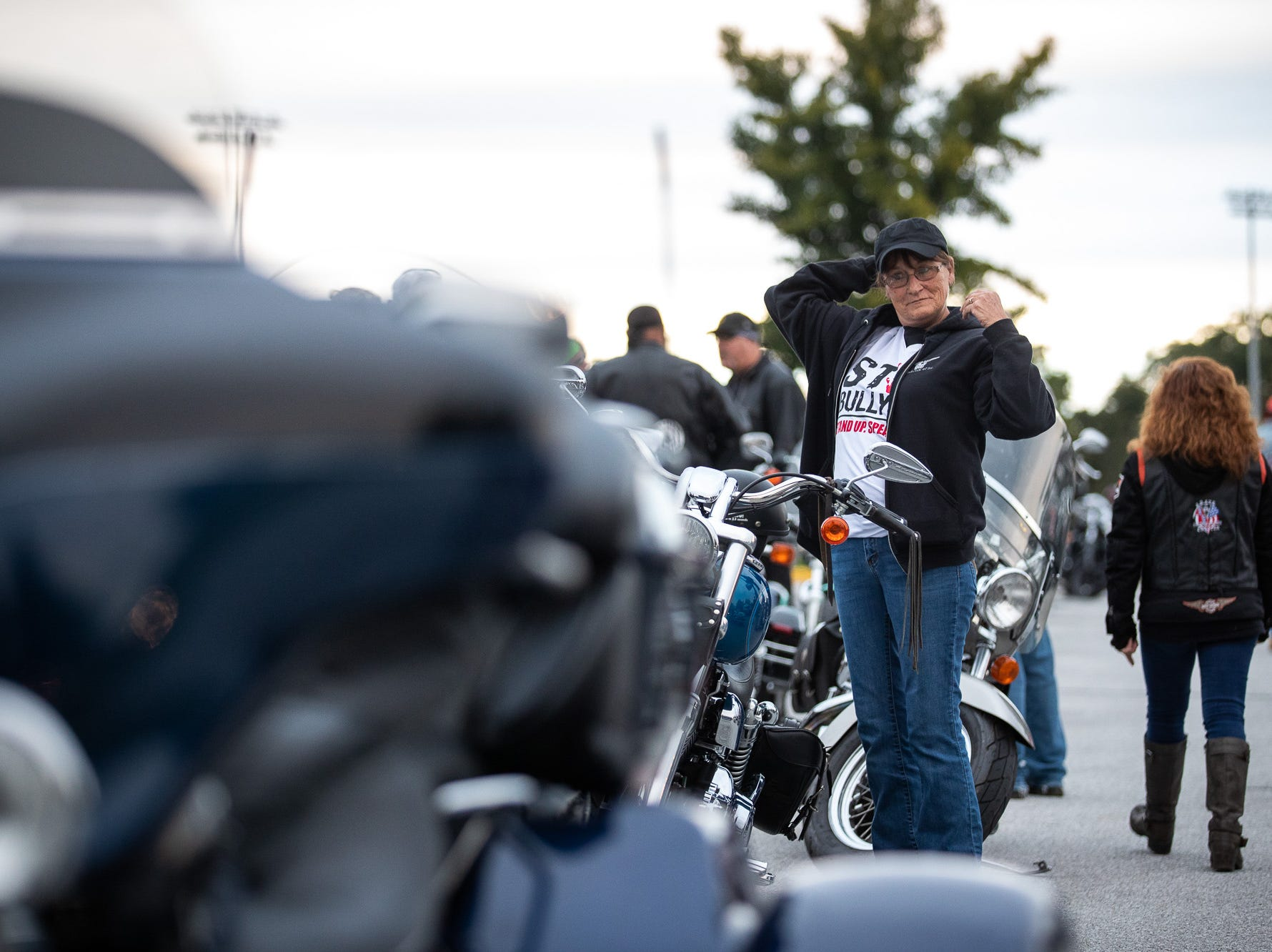 Dozens of members of the Alliance of Bikers Aimed Toward Education biker group prepare to roll out after escorting Aireana Mummerth, a 6th grader, to school at Emory H. Markle Intermediate School, Friday, Oct. 5, 2018, in Penn Township.