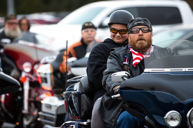 Aireana Mummerth, a 6th grader, smiles on the back of a bike as she arrives to school at Emory H. Markle Intermediate escorted by dozens of members of the Alliance of Bikers Aimed Toward Education biker group, Friday, Oct. 5, 2018, in Penn Township.
