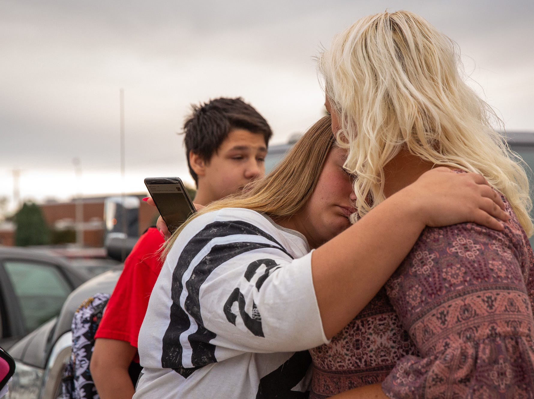 Aireana Mummerth, a 6th grader, embraces her mother, Amy Mummerth, after being escorted to school at Emory Markle Intermediate School by dozens of members of the Alliance of Bikers Aimed Toward Education biker group, Friday, Oct. 5, 2018, in Penn Township. The ride was organized to show their support for Aireana, who says she has been bullied.