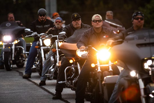 Dozens of members of the Alliance of Bikers Aimed Toward Education biker group prepare to roll out after escorting Aireana Mummerth, a 6th grader, to school at Emory Markle Intermediate School, Friday, Oct. 5, 2018, in Penn Township.