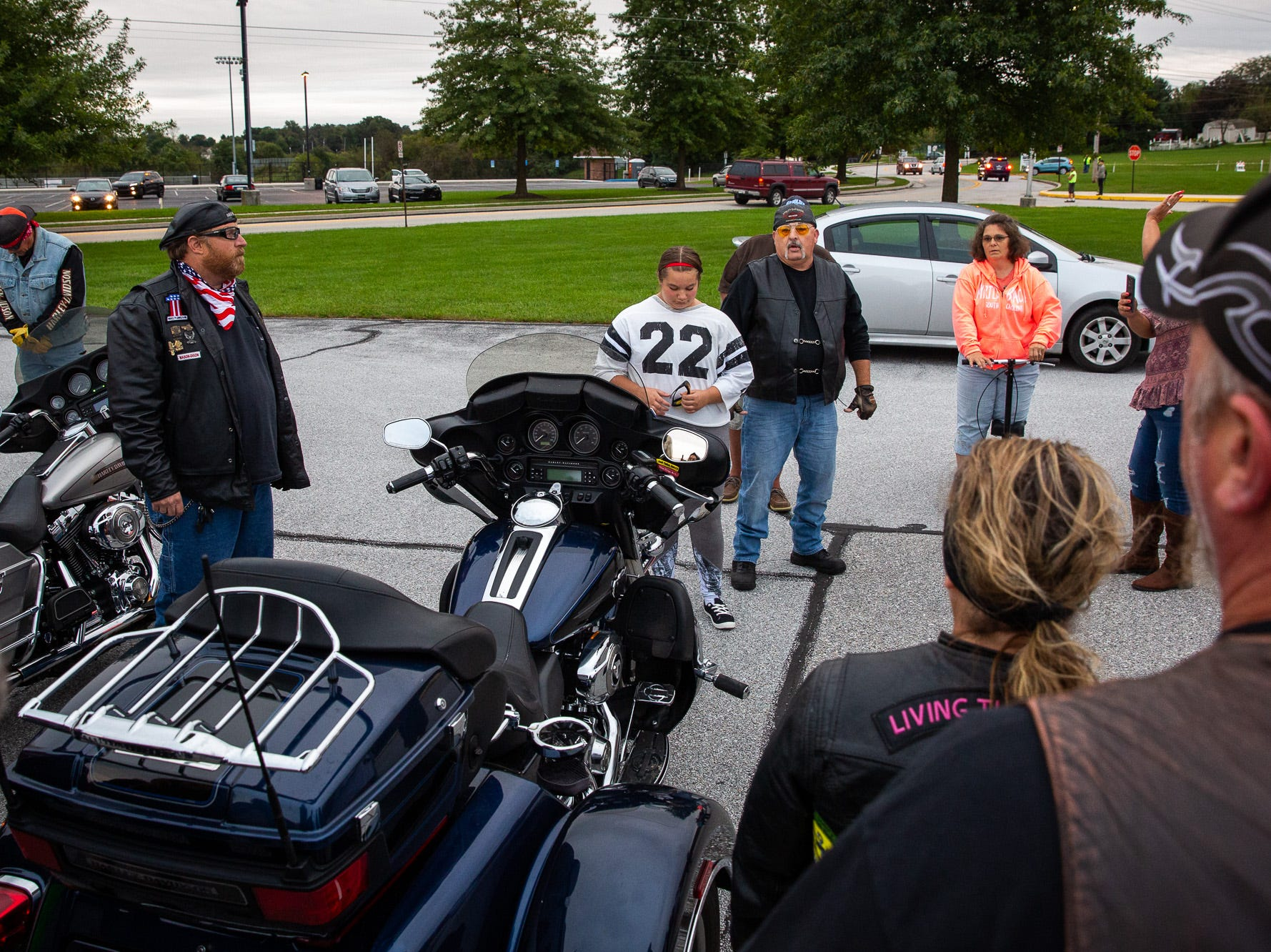 Byron Bechtel, a member of the Alliance of Bikers Aimed Toward Education biker group, speaks after escorting Aireana Mummerth, a 6th grader,  to school at Emory H. Markle Intermediate, Friday, Oct. 5, 2018, in Penn Township. The ride was organized to show their support for victims of bullying.