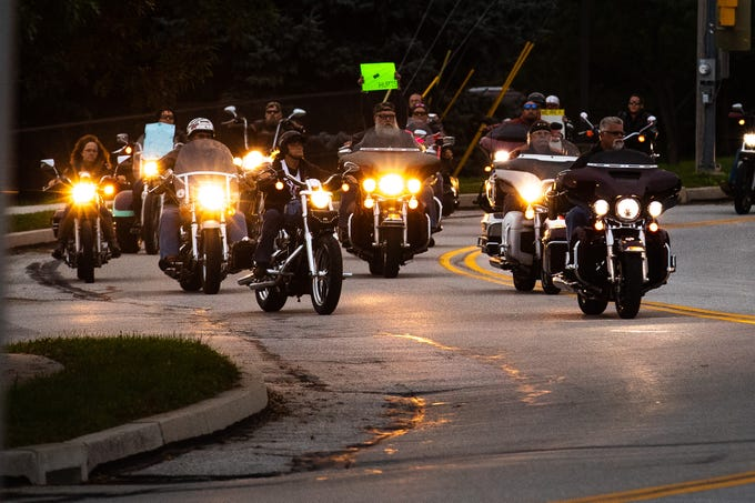 Dozens of members of the Alliance of Bikers Aimed Toward Education biker group escort Aireana Mummerth, a 6th grader, to school at Emory H. Markle Intermediate School, Friday, Oct. 5, 2018, in Penn Township. The ride was organized to show their support for Aireana, who says she has been bullied.