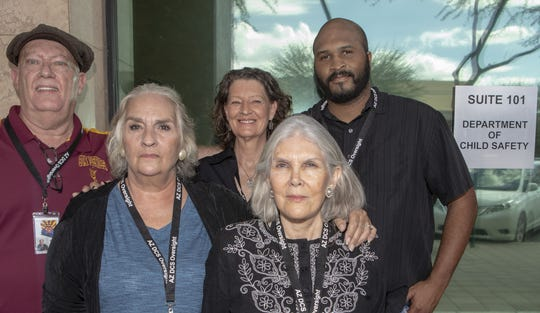 From left to right: Steven Isham, Karla Johnson, Lori Ford, Malinda Sherwyn, and David Watson are members of a group called Arizona DCS Oversight.