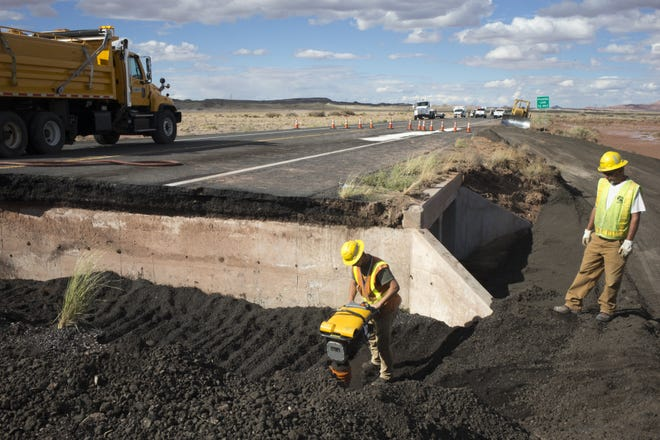 Workers begin repairing a section of U.S. 89 north of Flagstaff on Thursday. A portion of the road collapsed, and a subsequent crash left one woman dead.