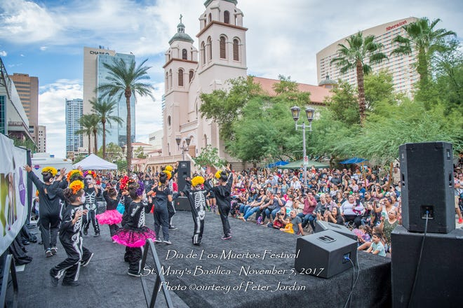 A performance takes place as part of the Dia de Los Muertos Festival at St. Mary's Basilica.