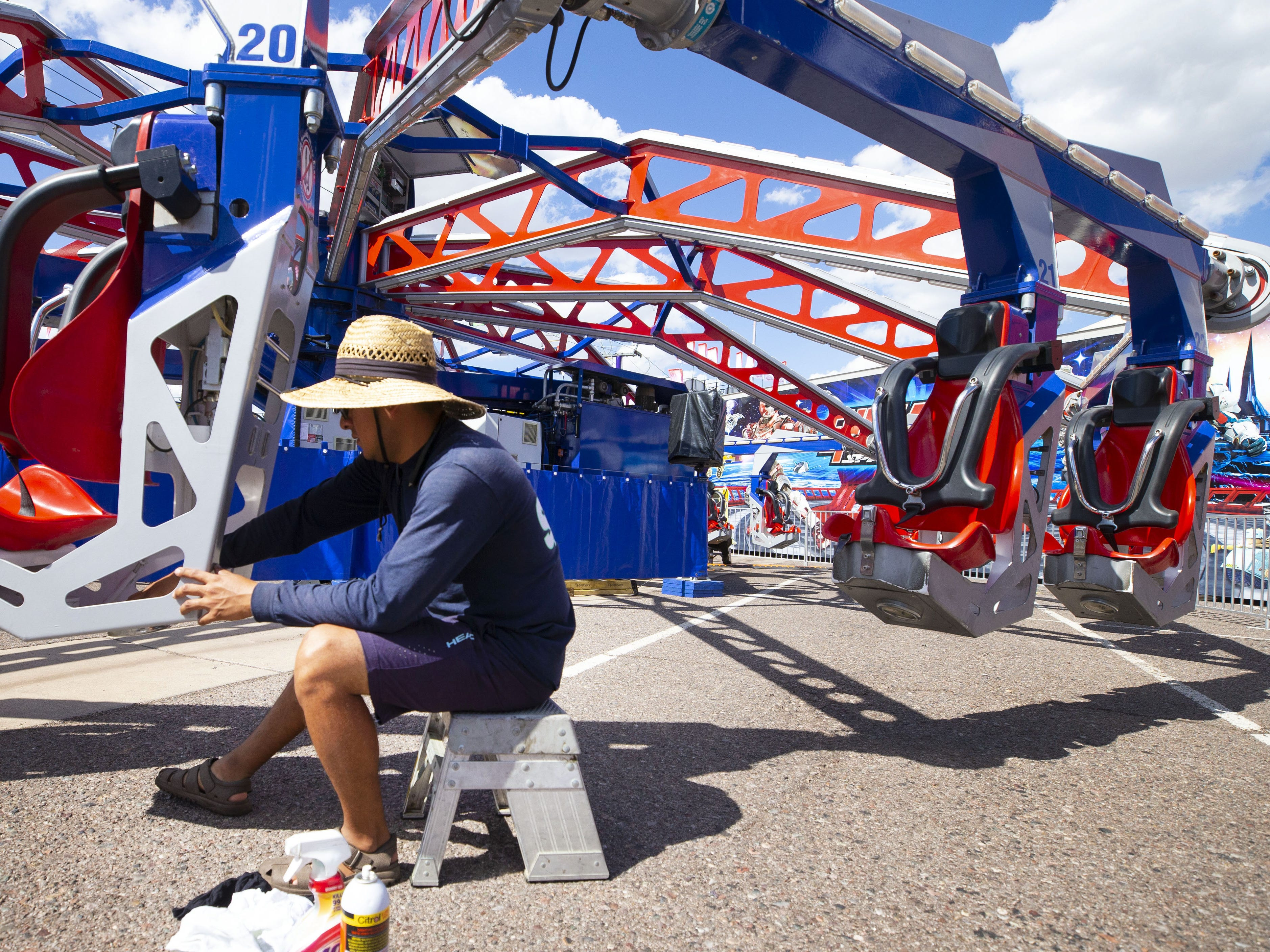 Jonathan Torres cleans the ride Endeavor at the Arizona State Fair in Phoenix on October 4, 2018. The Fair's opening day is Friday, October 5.