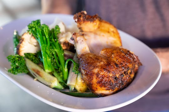 With a wood fired rotisserie in the kitchen, Phoenix Public Market Cafe specializes in slow cooked entrees like this signature chicken.