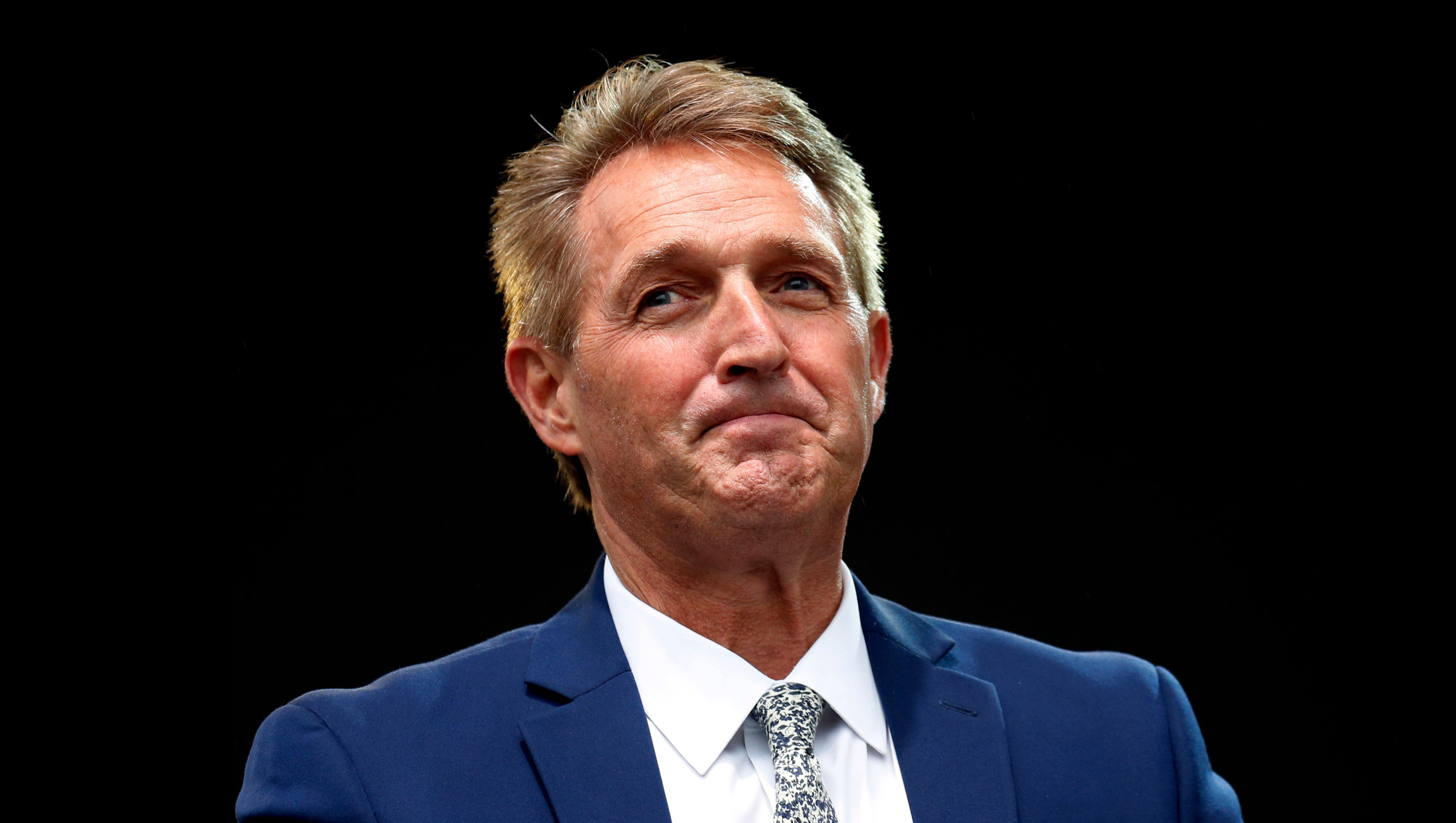 Man pleads guilty to threatening former Arizona Sen. Jeff Flake and his family