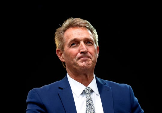Sen. Jeff Flake, R-Ariz., listens to a question during an appearance at the Forbes 30 Under 30 Summit, Monday, Oct. 1, 2018, in Boston.
