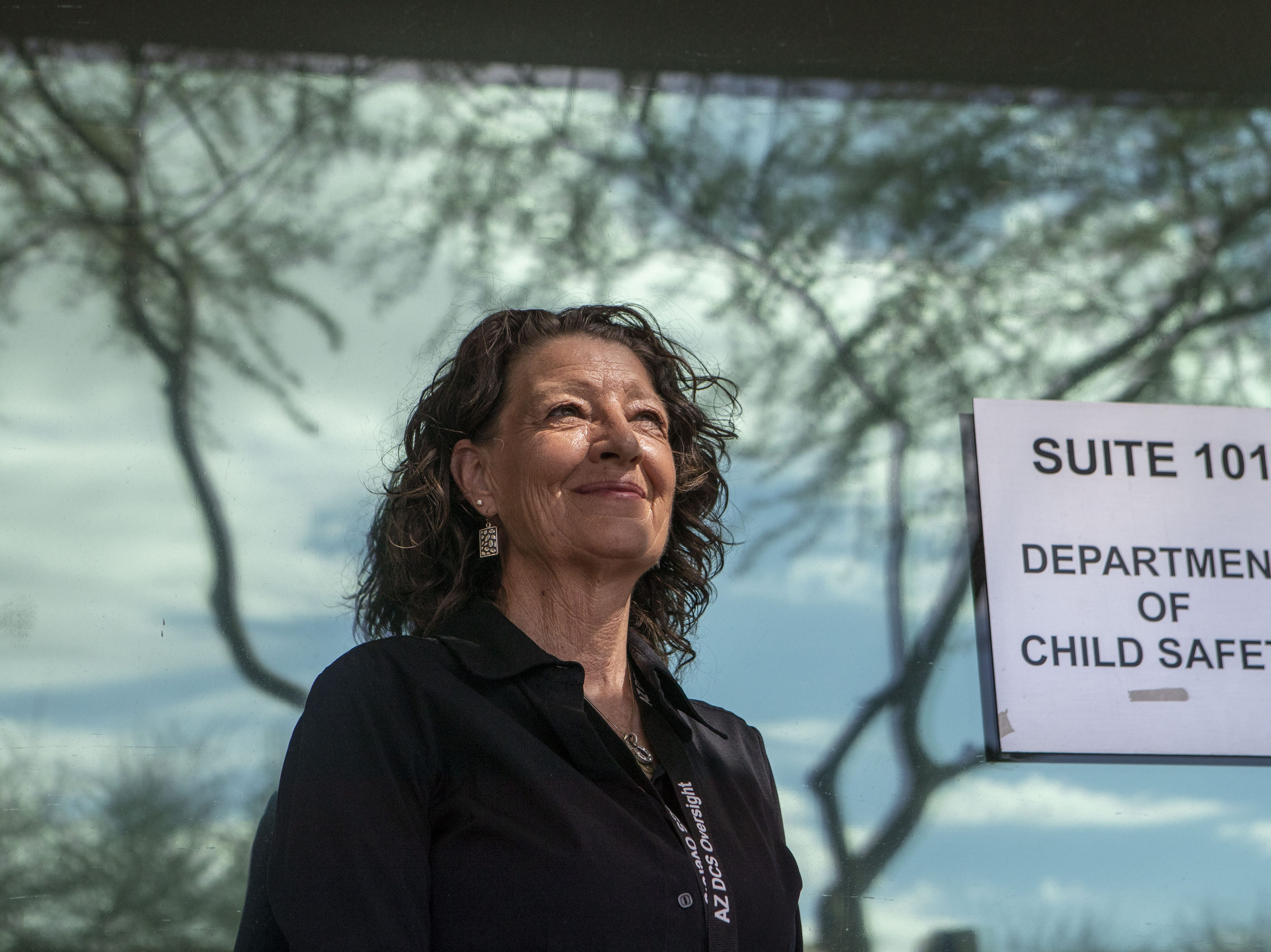 Lori Ford, one of the AZ DCS Oversight Group outside Mesa DCS office.