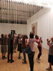 Fifth-graders from Sevilla West Elementary School in Phoenix explore an interactive exhibit at Phoenix Art Museum on a field trip paid for by the nonprofit Act One.