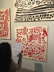 One of Candace Green's art students from Sevilla West Elementary School in Phoenix studies a piece of art on a museum field trip paid for by the nonprofit Act One.