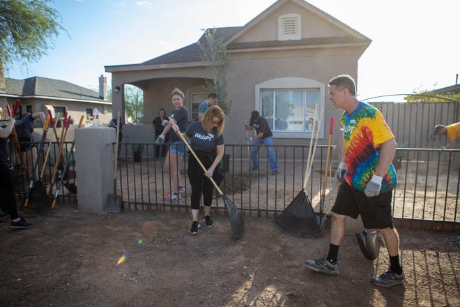 Volunteers from Habitat for Humanity, which has begun focusing on housing rehabilitation in the central city south neighborhood near downtown Phoenix, work on a home on Sept. 21, 2018.