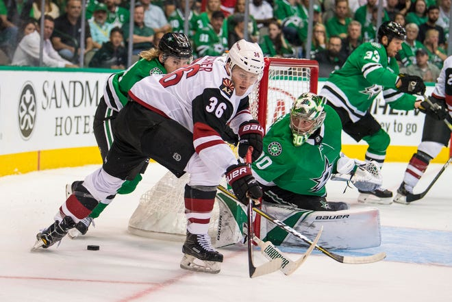 Oct 4, 2018; Dallas, TX, USA; Dallas Stars goaltender Ben Bishop (30) pokes the puck away from Arizona Coyotes right wing Christian Fischer (36) during the first period at American Airlines Center.