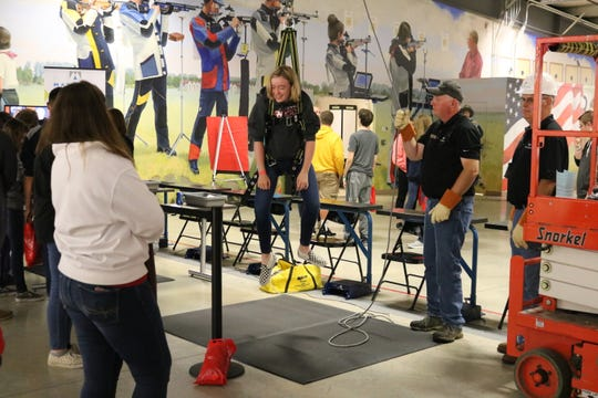 Sydney Moore, of Port Clinton High School, is hoisted into the air at this station provided by Materion at the fifth annual Ottawa County Career Showcase on Friday.
