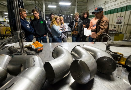 PauMac Tubing welder John Carson, right, talks about product plans with a group of Marysville High School sophomores during a tour on Manufacturing Day Friday, Oct. 5, 2018 at the PauMac plant in Marysville.