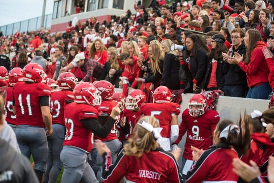 Port Huron High School football players cheer with the student section Friday, Oct. 5, 2018 before the Crosstown Showdown at Memorial Stadium.