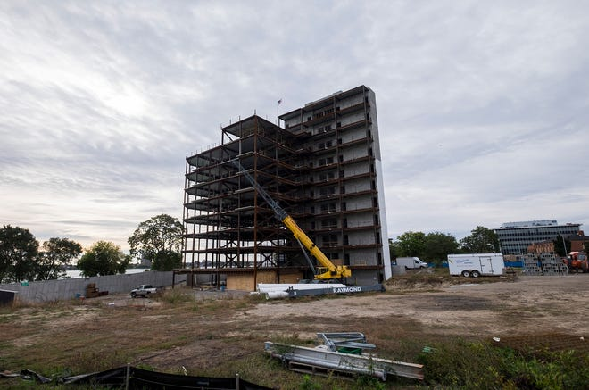 The frame of the first tower of the Bluewater View condos in Port Huron has reached its final height of 136 feet. The tower is 11 stories including underground parking and will house 29 units.