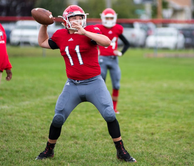 Port Huron High School tight end Phil Mackay throws a pass Friday, Oct. 5, 2018 during a warmup drill before the Crosstown Showdown at Memorial Stadium.