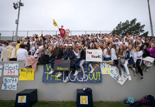 Port Huron Northern High School students wave signs before the Crosstown Showdown Friday, Oct. 5, 2018 at Memorial Stadium.
