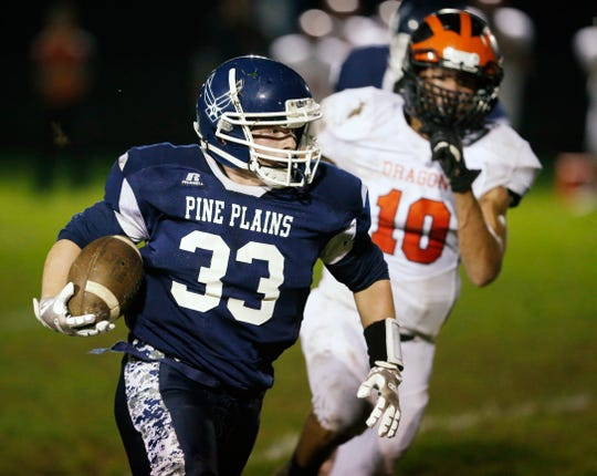 Pine Plains' Kyle Stracher carries the ball for a gain during Thursday's game versus Dover at Stissing Mountain High School on October 4, 2018.