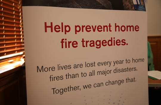 A sign from the American Red Cross bearing a message about preventing house fires sits at the press conference on Friday. Both the Red Cross and Rebuilding Together Dutchess County have programs that provide fire alarms to households.