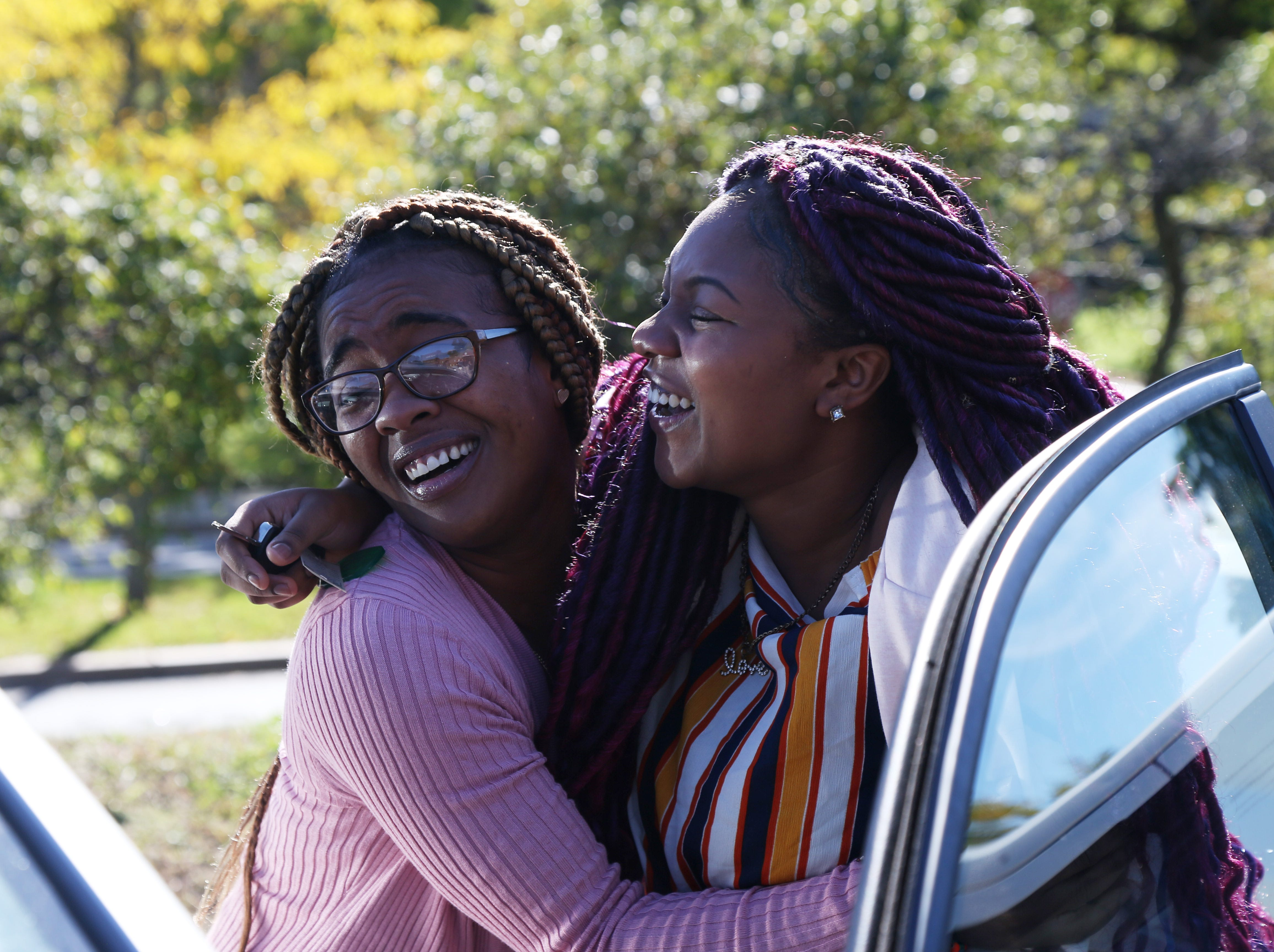 From left, Nikesha Porter and Shelisha Melton embrace following a ceremony where they were given cars as part of the Dutchess County Department of Community and Family Services Wheels to Work program on October 5, 2018. The two are planning to use their new cars to get to work and care for their families.
