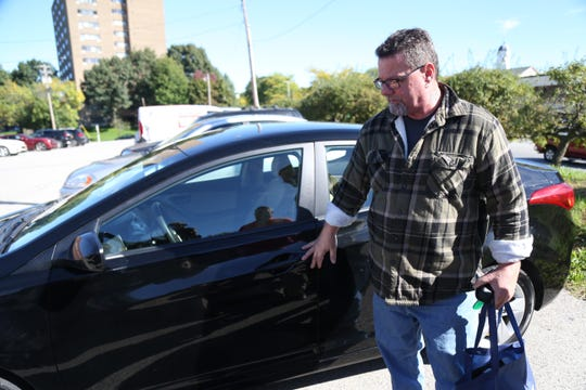 Mark Gildow looks over his 'new' car which he received as as part of the Dutchess County Department of Community and Family Services Wheels to Work program on October 5, 2018. Gildow, a US Navy veteran was given his car as part of an expansion of the program to assist veterans in the community.