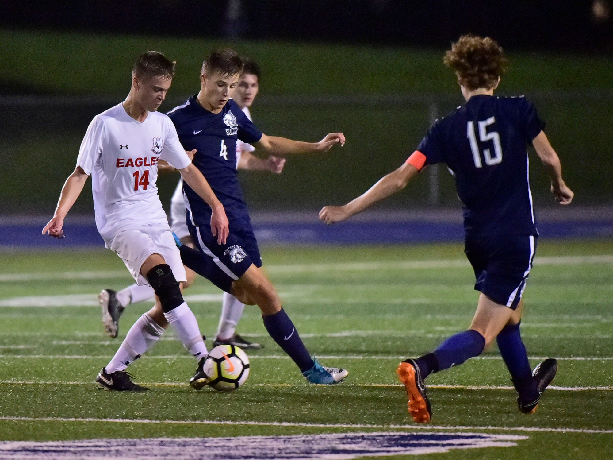 CV's Eric Leach (14) dribbles the ball past Luke Myers (4). Chambersburg hosted Cumberland Valley in PIAA soccer on Thursday, Oct. 4, 2018, but dropped a 2-1 match in double overtime.