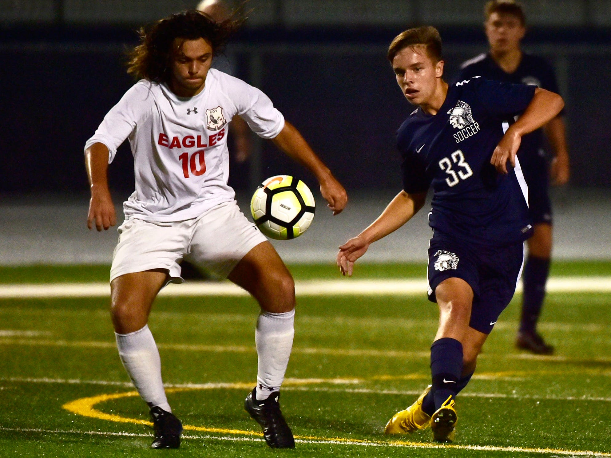 CV's Greg Congle (10) controls the ball in front of Tanner Luther (33) of Chambersburg. Chambersburg hosted Cumberland Valley in PIAA soccer on Thursday, Oct. 4, 2018, but dropped a 2-1 match in double overtime.